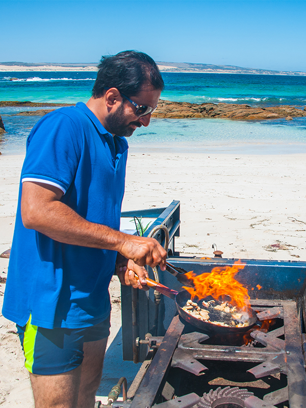 Rishad on the Eyre peninsula cooking abalone